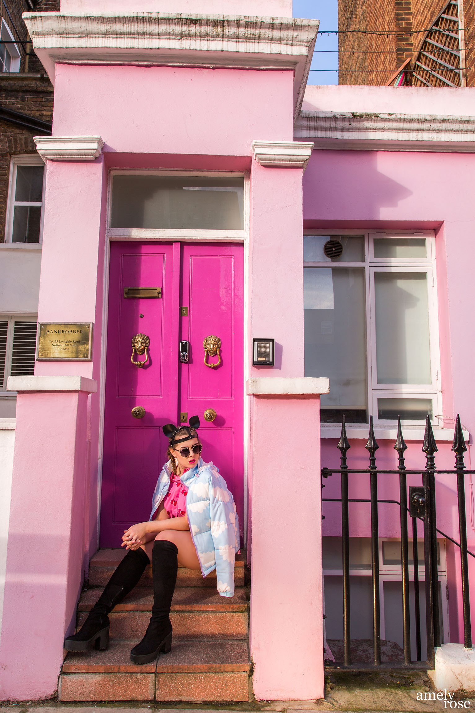pink Barbie house and Amely Rose wearing a cloud jacket