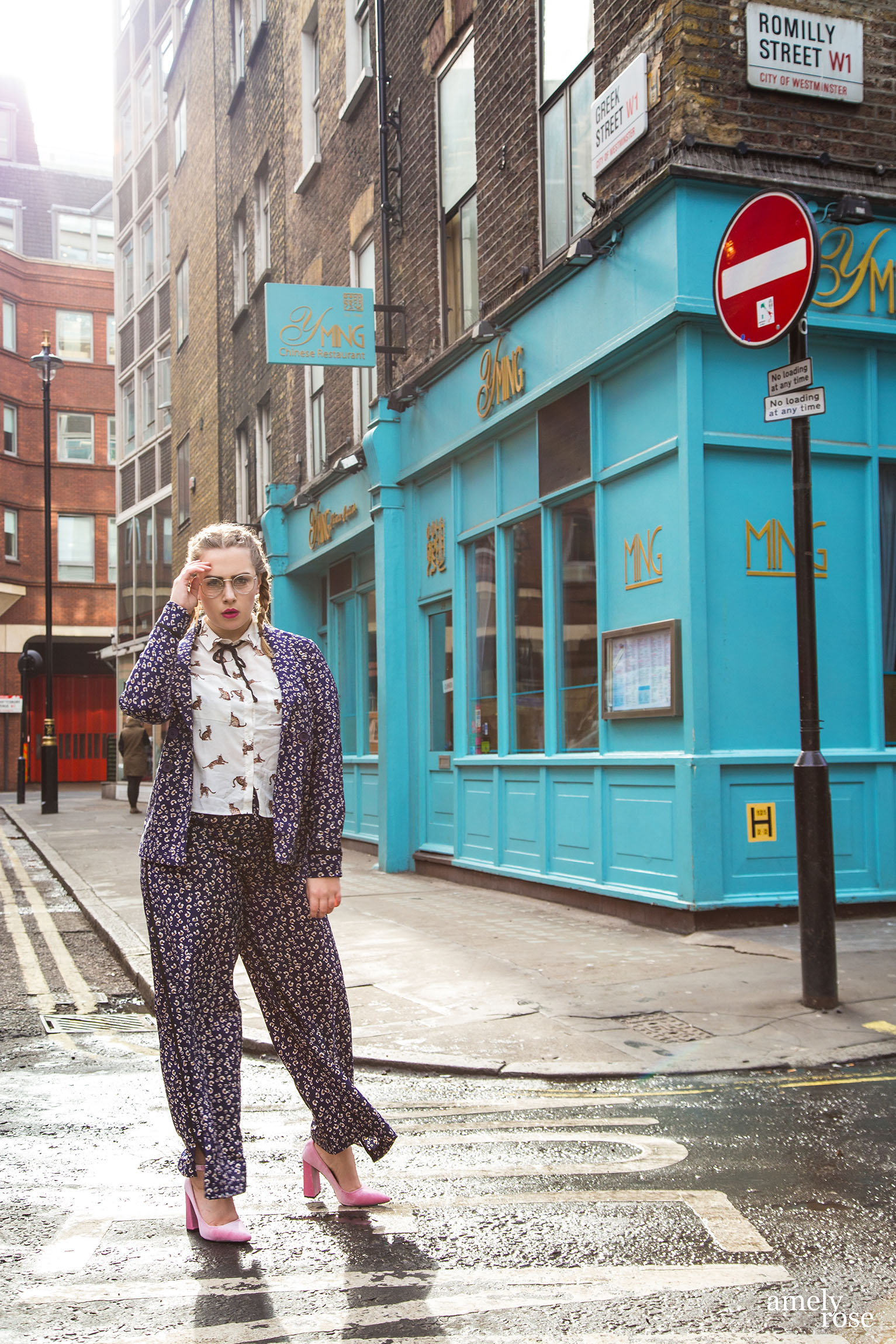 Amely Rose wearing a blue business two piece in London.